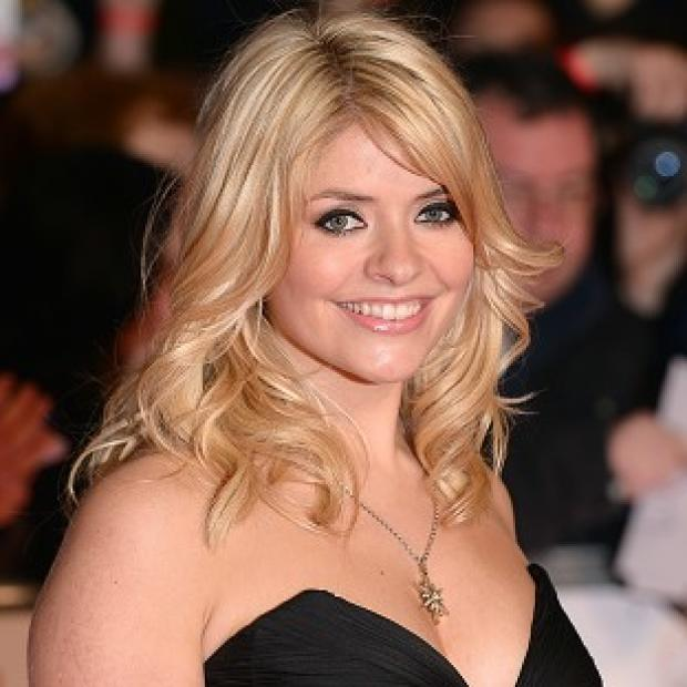 Lancaster And Morecambe Citizen: Pregnant TV presenter Holly Willoughby says she is determined to work until she goes into labour