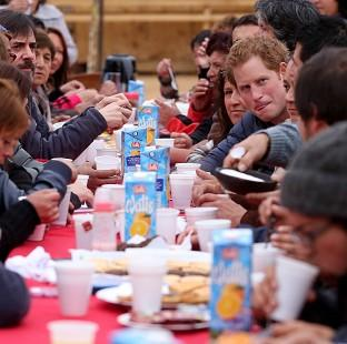 Lancaster And Morecambe Citizen: Prince Harry has tea with residents in Valparaiso during his visit to Chile