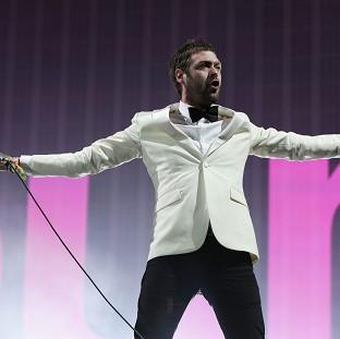 Lancaster And Morecambe Citizen: Tom Meighan of Kasabian performing on the Pyramid Stage at the Glastonbury Festival