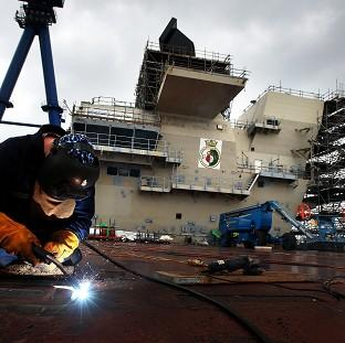 Lancaster And Morecambe Citizen: HMS Queen Elizabeth has been pieced together at Rosyth Dockyard in Fife