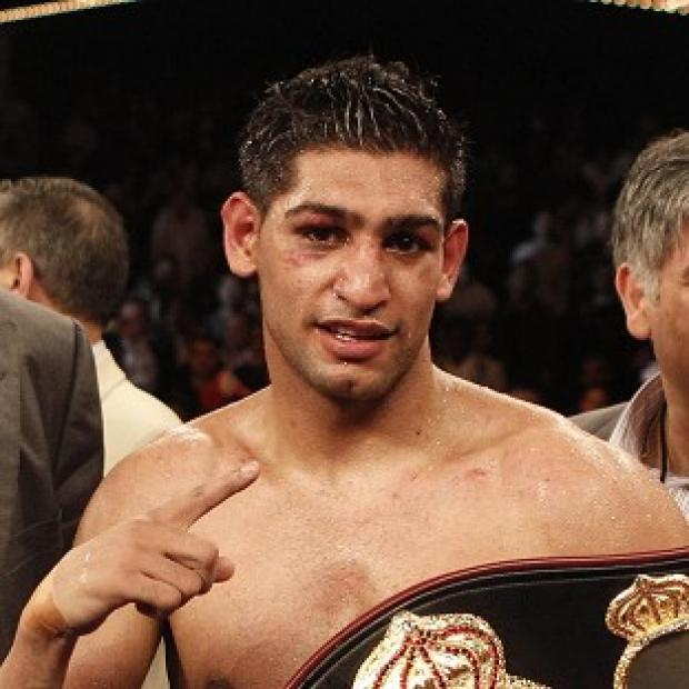 Lancaster And Morecambe Citizen: Boxer Amir Khan was arrested over an alleged assault in Bolton