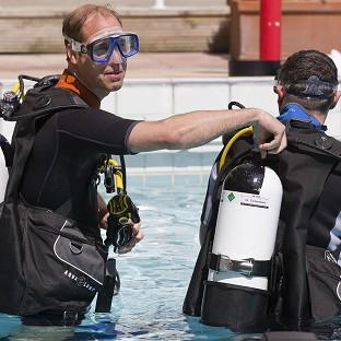 Lancaster And Morecambe Citizen: The Duke of Cambridge makes safety checks with BSAC chairman Eugene Farrell before scuba diving with British Sub-Aqua Club members at a swimming pool in London