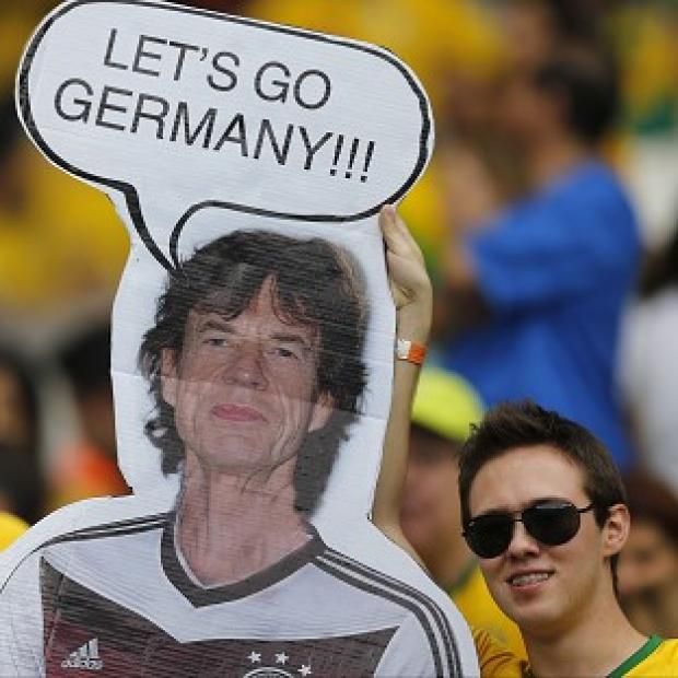 Lancaster And Morecambe Citizen: Brazil fans hold a poster depicting Rolling Stones singer Sir Mick Jagger wearing a Germany shirt before the World Cup semifinal match between Brazil and Germany (AP)