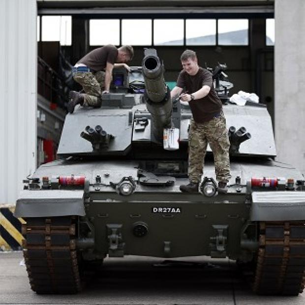 Lancaster And Morecambe Citizen: Trooper Tony Gibbs, of Yeovil (right), paints the barrel of a Challenger 2 tank alongside Trooper Scott Smith from Nottingham