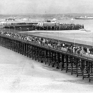 Lancaster And Morecambe Citizen: Ryde pier during the Fleet Review of 1977 with Britannia, as the 200th anniversary of the opening of Britain's first seaside pier, Ryde pier on the Isle of Wight, is being today.