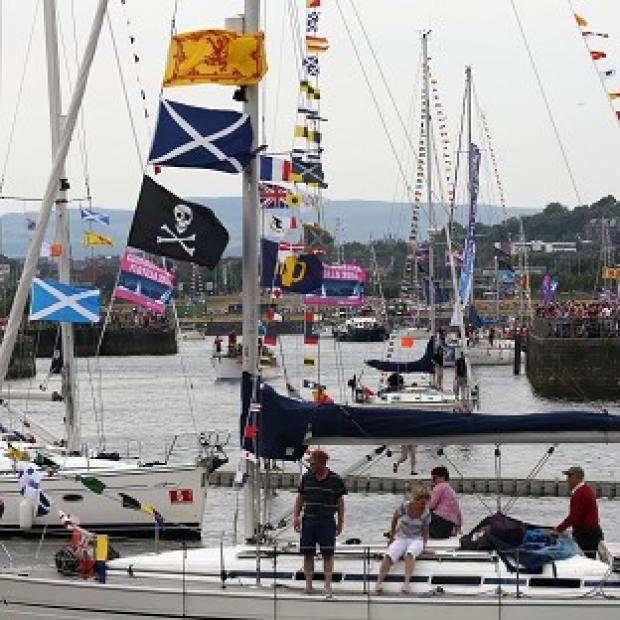 Lancaster And Morecambe Citizen: The largest flotilla ever seen on the River Clyde sails into Glasgow as part of the city's Commonwealth Games celebrations