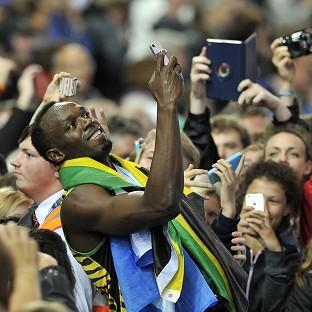 Lancaster And Morecambe Citizen: Usain Bolt takes a selfie with fans after winning the Men's 4x100m Relay at Hampden Park