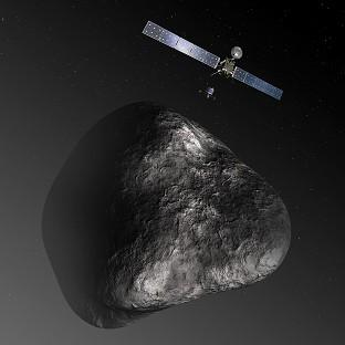 Lancaster And Morecambe Citizen: An artist's impression of Rosetta and its lander Philae approaching comet 67P/Churyumov-Gerasimenko (European Space Agency)