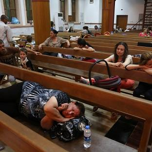 Lancaster And Morecambe Citizen: Displaced Iraqi Christians settle at St Joseph Church in Irbil, northern Iraq, after militants overran a cluster of predominantly Christian villages alongside the country's semi-autonomous Kurdish region (AP)
