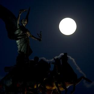Lancaster And Morecambe Citizen: A 'supermoon' appears behind the Angel of Peace sculpture in London (AP)