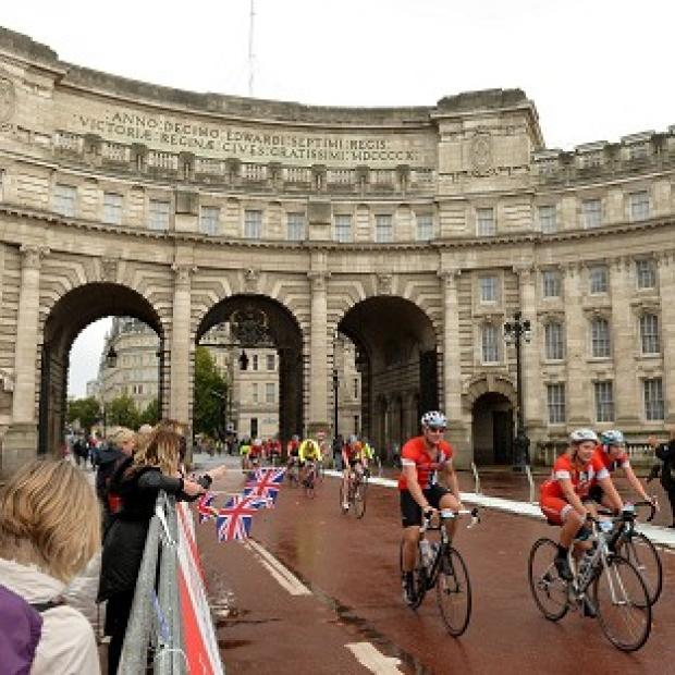 Lancaster And Morecambe Citizen: Cyclists make their way through Admiralty Arch on The Mall in the Prudential RideLondon-Surrey 100