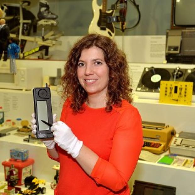 Lancaster And Morecambe Citizen: Charlotte Connelly of the Science Museum holds an IBM Simon mobile phone from 20 years ago