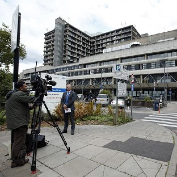 Lancaster And Morecambe Citizen: Media gather outside the Royal Free Hospital, where a British volunteer nurse who contracted Ebola is being treated