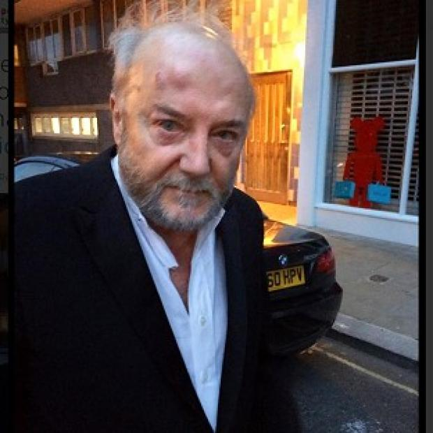Lancaster And Morecambe Citizen: George Galloway on his way to hospital after being attacked in L