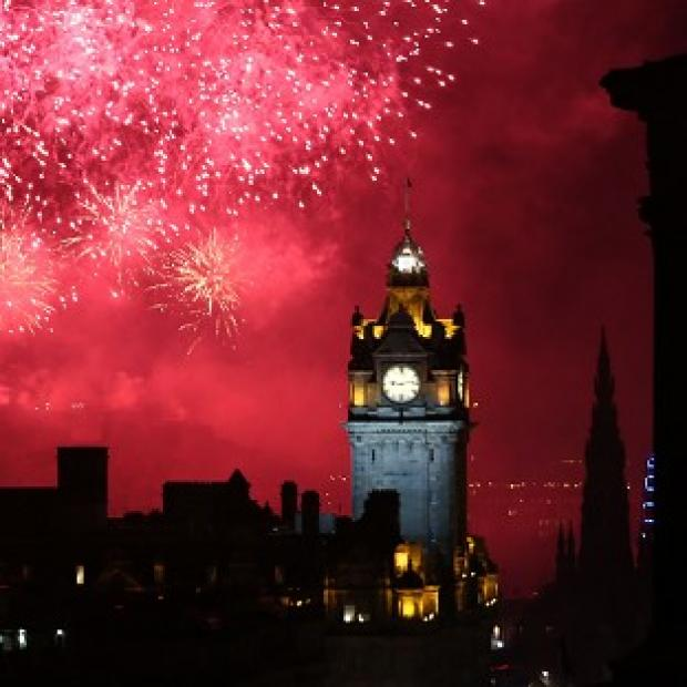 Lancaster And Morecambe Citizen: Edinburgh lights up during the Virgin Money Fireworks Concert, the traditional closing act in the city's busy festival calendar