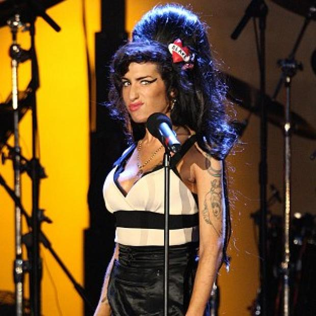 Lancaster And Morecambe Citizen: Amy Winehouse performs during the Hyde Park concert marking Nelson Mandela's 90th birthday