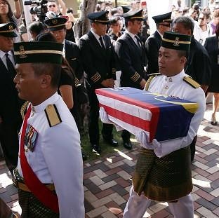 Lancaster And Morecambe Citizen: Malaysian soldiers carry an urn containing the ashes of pilot Eugene Choo of Flight MH17, which was shot down over eastern Ukraine in July (AP)