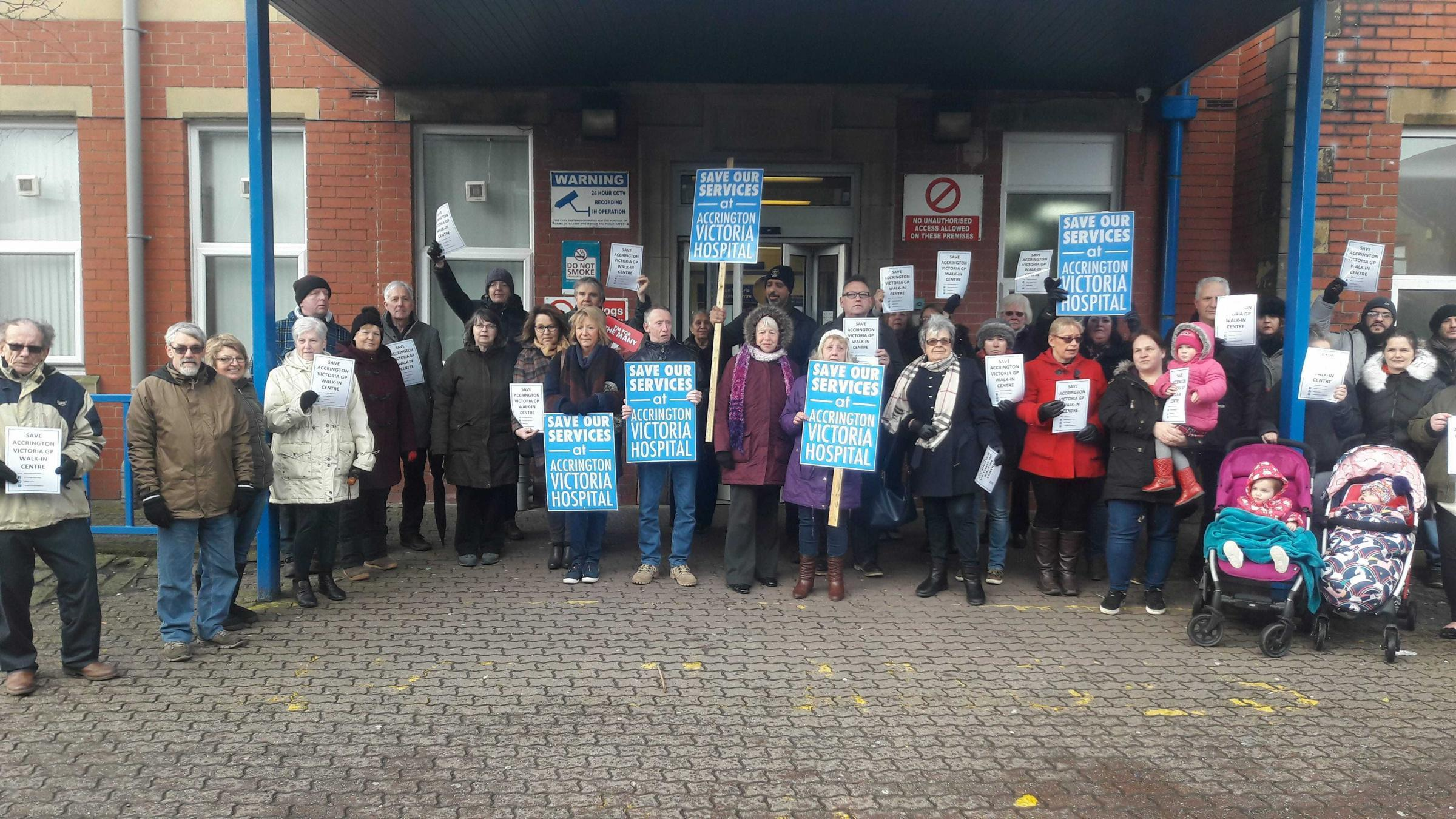 Protestors outside the walk-in centre at Accrington Victoria Community Hospital