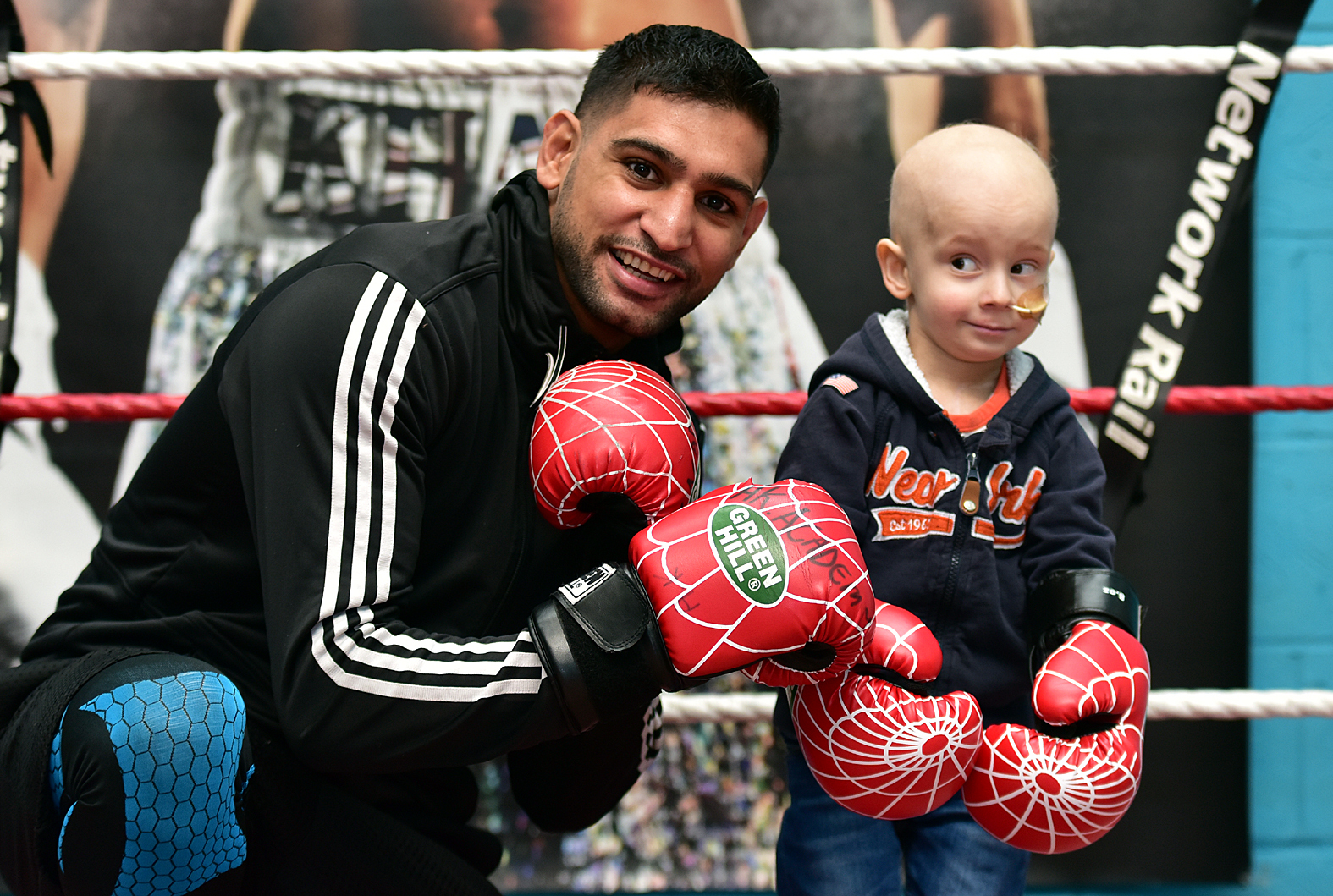 Oliver Welch aged three who is suffering from a rare form of cancer, met Amir Khan at his gym in Bolton.