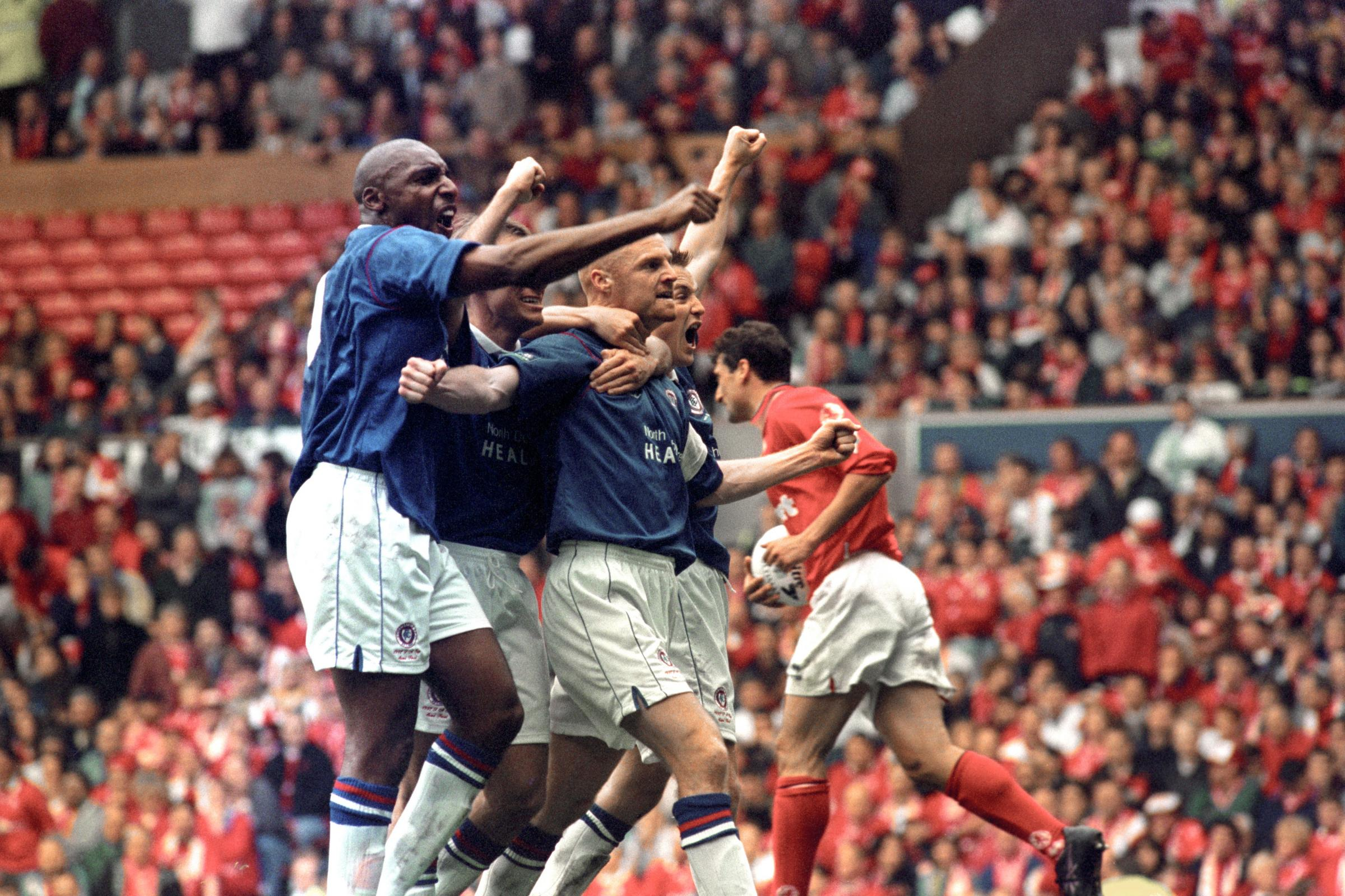 Sean Dyche, centre, celebrates with team-mates after scoring in Chesterfield's FA Cup semi-final with Middlesbrough