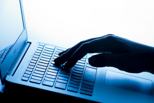 File photo dated 04/03/17 of a person using a laptop, as the Home Secretary Amber Rudd is to launch a crackdown on criminals who exploit the internet underworld known as the dark web. PRESS ASSOCIATION Photo. Issue date: Wednesday April 11, 2018. On Wedne