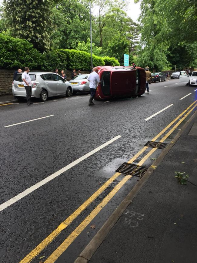 A car flipped onto its side after crashing with another vehicle on Preston New Road